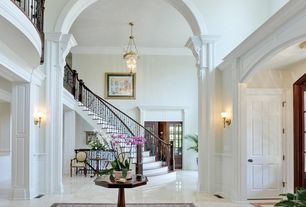 Traditional Staircase with Crown molding, High ceiling, Chandelier, Hardwood floors