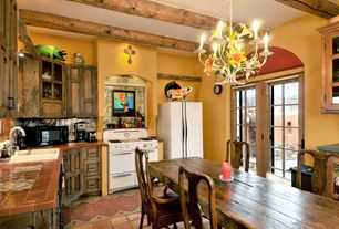 Country Kitchen with Glass panel, Chandelier, terracotta tile floors, Exposed beam, Raised panel, French doors