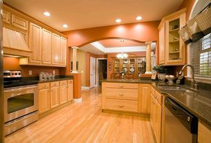 Traditional Kitchen with Inset cabinets, Oak - natural 2 1/4 in. solid hardwood strip, Custom hood, Undermount sink, Columns