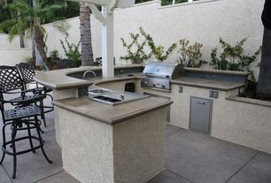 Eclectic Patio with exterior tile floors, Fence, exterior concrete tile floors, Outdoor kitchen