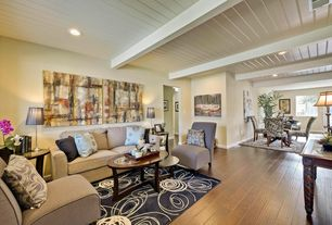 Contemporary Living Room with Exposed beam, can lights, Hardwood floors, picture window, Standard height