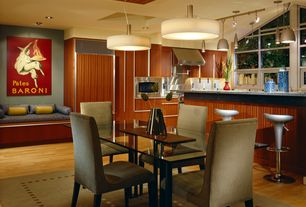 Contemporary Dining Room with Hardwood floors, Pendant light
