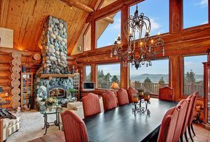 Rustic Dining Room with terracotta tile floors, picture window, Exposed beam, High ceiling, Chandelier, Casement
