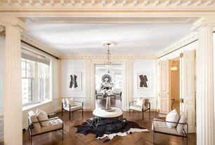 Contemporary Living Room with Hardwood floors, Crown molding, Columns, Pendant light, Chair rail, Wainscotting