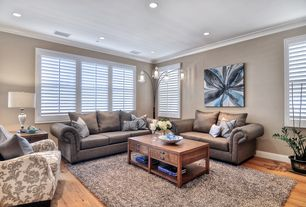 Contemporary Living Room with Crown molding, Standard height, Hardwood floors, can lights, Wildon home charles sofa, Casement