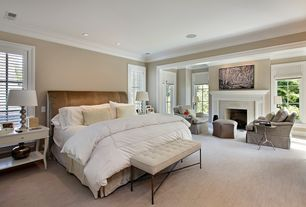 Traditional Master Bedroom with can lights, Carpet, Crown molding, Casement, Cement fireplace, Standard height, Paint 2
