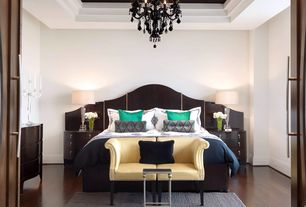 Contemporary Master Bedroom with Loveseat, Chandelier, Wood headboard, Carpet, Area rug, Table lamp, Double doors