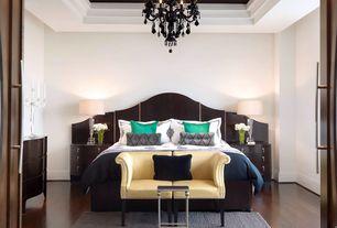 Contemporary Master Bedroom with Table lamp, Double doors, Wood headboard, Area rug, Loveseat, Built-in bookshelf, Carpet