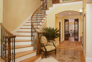 Mediterranean Staircase with Loft, curved staircase, can lights, Laminate floors, Cathedral ceiling, Crown molding