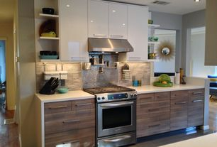 Contemporary Kitchen with Corian counters, slate tile floors, Metal Tile, Stone Tile, Flush, European Cabinets, One-wall