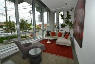 Modern Living Room with Concrete floors, picture window, Standard height
