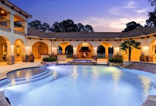 Mediterranean Swimming Pool with double-hung window, Raised beds, Deck Railing, French doors, exterior stone floors