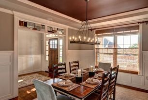 Traditional Dining Room with Wainscotting, Standard height, Crown molding, Chandelier, double-hung window, Hardwood floors