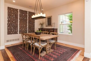 Eclectic Dining Room with Chandelier, Hardwood floors