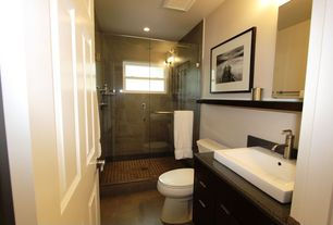 Contemporary 3/4 Bathroom with Simple Granite, Simple granite counters, frameless showerdoor, limestone tile floors, Flush