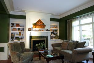 Traditional Living Room with Hardwood floors, Wainscotting, stone fireplace, Crown molding, Built-in bookshelf