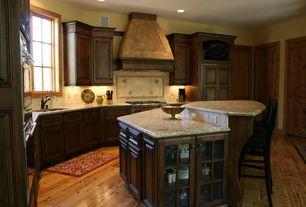 "Traditional Kitchen with Wolfe - 36"" dual fuel range - 6 burners, Flat panel cabinets, Kitchen island, Custom hood"
