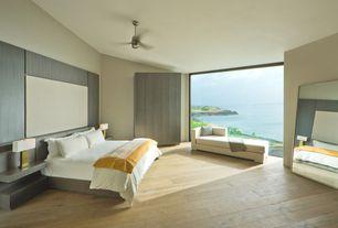 Modern Master Bedroom with Ceiling fan, Truemodern jackson chaise, Hardwood floors