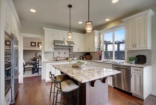 Traditional Kitchen with Stone Tile, U-shaped, Kitchen island, Complex granite counters, Pendant light, Limestone Tile, Flush