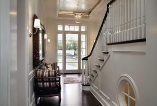 Traditional Entryway with Wainscotting, Standard height, Chair rail, French doors, Wall sconce, Hardwood floors