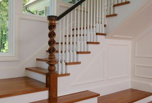 Traditional Staircase with Hardwood floors
