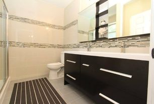 Contemporary Master Bathroom with Double sink, Subway Tile, Corian counters, European Cabinets, Undermount sink, Flush