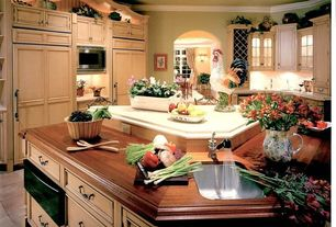 Country Kitchen with U-shaped, Glass panel, Stone Tile, Limestone counters, Wood counters, Flat panel cabinets, Flush