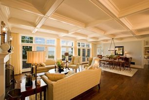 Traditional Great Room with Hardwood floors, Transom window, Table lamp, Area rug, Coffered ceiling, Wall sconce, Chandelier