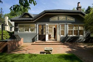 Cottage Patio with Fire pit, Pathway, Arched window, Glass panel door, Outdoor kitchen, exterior brick floors