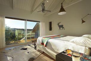 Contemporary Guest Bedroom with Hardwood floors, flush light, Exposed beam, Built-in bookshelf, High ceiling, Ceiling fan