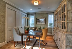 Contemporary Home Office with Crown molding, Built-in bookshelf, flush light, specialty door, Hardwood floors