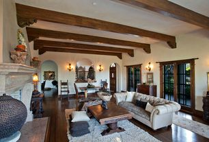 Eclectic Living Room with Paint 1, Old World Stoneworks Fireplace Mantel, Standard height, Wall sconce, French doors