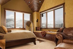 Rustic Master Bedroom with specialty window, can lights, Cathedral ceiling, Window seat, Hardwood floors, Wall sconce