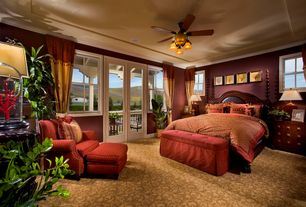 Mediterranean Master Bedroom with French doors, Crown molding, Chandelier, Ceiling fan, Carpet