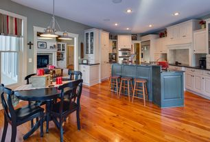 Country Dining Room with Pendant light, double-hung window, Standard height, Hardwood floors