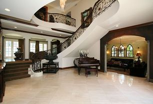 Art Deco Entryway with Emser-st. moritz ivory 18 in. x 18 in. porcelain floor and wall tile, Columns, French doors