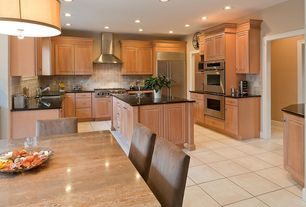 Traditional Kitchen with U-shaped, Stone Tile, Limestone Tile, Kitchen island, Simple granite counters, Raised panel