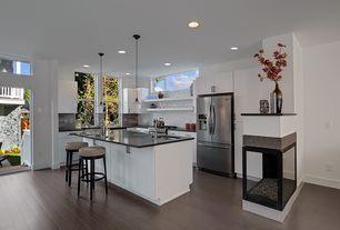 Contemporary Kitchen with gas range, Undermount sink, Subway Tile, Breakfast bar, European Cabinets, can lights, Flush