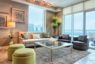 Contemporary Living Room with flush light, travertine tile floors