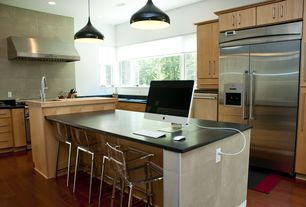 Modern Kitchen with L-shaped, Standard height, Wood counters, Pendant light, gas range, can lights, Limestone Tile, Casement