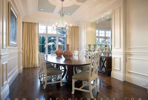 Contemporary Dining Room with Chair rail, Wainscotting, Crown molding, Chandelier, Built-in bookshelf, Hardwood floors