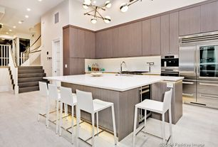 Contemporary Kitchen with Kitchen island, can lights, electric cooktop, Breakfast bar, Wine refrigerator, Paint, L-shaped