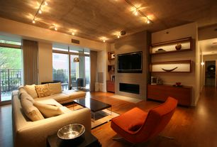 Contemporary Living Room with flush light, Modern Arm Chair, Built-in bookshelf, Hardwood floors, Yield Coffee Table