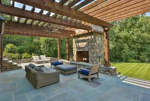 Traditional Patio with exterior stone floors, Raised beds, Trellis, Deck Railing