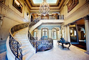 Traditional Staircase with limestone floors, High ceiling, interior wallpaper, Wall sconce, travertine floors, Chandelier