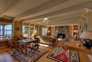 Eclectic Great Room with Built-in bookshelf, Exposed beam, stone fireplace, Hardwood floors