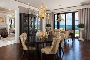 Traditional Dining Room with Chandelier, Crown molding, Hardwood floors