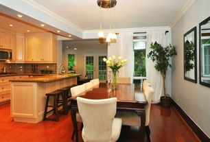 Traditional Dining Room with Crown molding, Hardwood floors, Pendant light