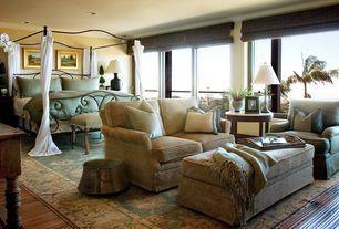 Tropical Master Bedroom with Crown molding, Hardwood floors