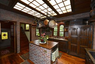 Traditional Kitchen with Wood counters, Kitchen island, Arched window, Hardwood floors, Undermount sink, Inset cabinets